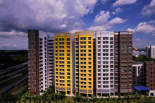 Singapore. Wide View Of Block Of Typical Public Housing (HDB Flats) In Heartland Canberra Estate On Bright Sunny Day, Cloudy Blue Sky. Architecture Shot; Panoramic Wide Angle.