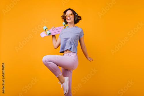 Valokuva Slim stunning woman in summer attire having fun in studio