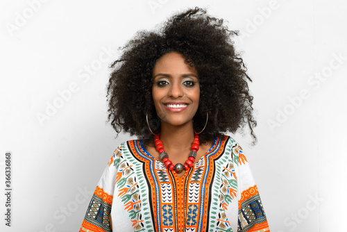 Fotografering Young beautiful African woman with Afro hair wearing traditional clothes