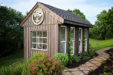 Old Wooden Garden Shed And Stone Foot Path In A Cottage Garden In The Country