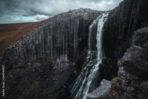 Fototapeta Studlafoss waterfall with basalt columns in East Iceland