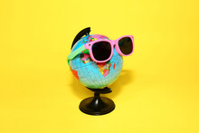 Globe In Sunglasses On A Yello...