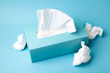 Cold And Flu Concept With A Tissue Box And Crumpled Tissues