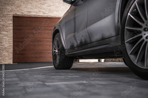 Fotografia, Obraz Modern Car on a Driveway in Front of Garage
