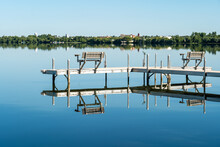 A Dock With Inviting Benches I...
