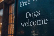Dogs Welcome Sign Outside A Pu...