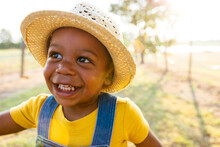 Portrait Of Smiling Boy Standi...