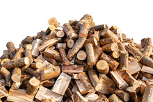 A Firewood Stacked In A Pile, Lying In The Sun, Close Up Shot, Wooden Background, Isolated On A White Background Witha A Clipping Path.