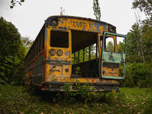 Outside View Of The Back Of An Abandoned School Bus