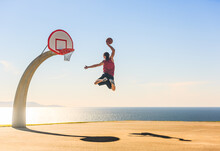 Basketball Player Jumping In T...