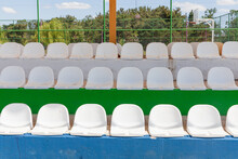 Picture Of Empty Sports Tribune. White Plastic Sits On The Stadium.