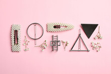 Stylish Hair Clips And Flowers On Pink Background, Flat Lay