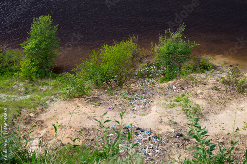Fotografie, Tablou Garbage dump on a cliff on the river bank
