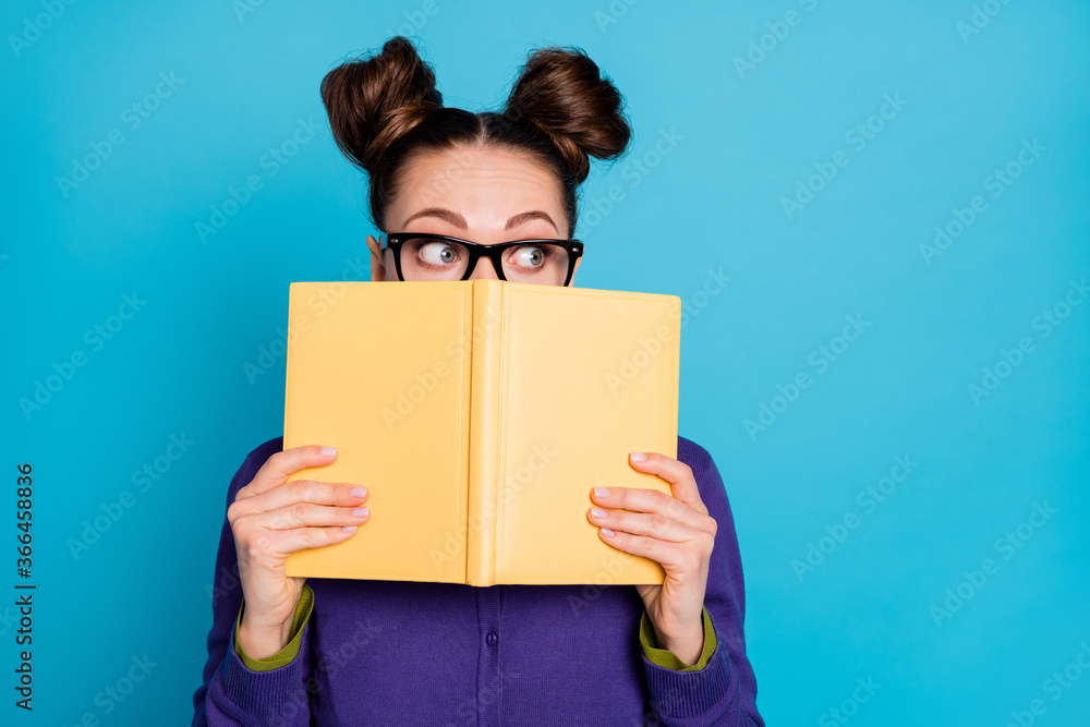 Fototapeta Close-up portrait of her she nice attractive smart clever scared modest schoolgirl hiding behind book task reading isolated on bright vivid shine vibrant blue green teal turquoise color background