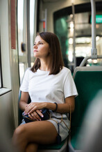 Portrait Of Young Woman Going To Work By Bus Or Trolley At Early Morning
