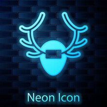 Glowing Neon Deer Antlers On Shield Icon Isolated On Brick Wall Background. Hunting Trophy On Wall. Vector.