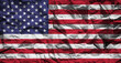 Flag of the United States of America on crumpled paper. Flag printed on a sheet. Flag image for design on flyers, advertising.
