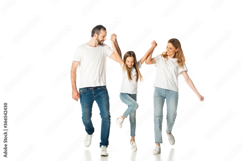 Fototapeta happy casual family holding hands while walking isolated on white