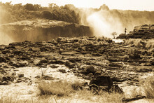 Victoria Falls From The Zambian Side, Deep River Gorge With Vertical Sides And Mist From Tumbling Water.