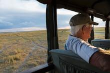 Senior Man In Safari Vehicle, Kalahari Desert, Makgadikgadi Salt Pans, Botswana