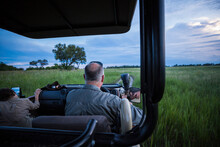 Rear View Of Safari Guide Driv...