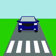 Blue Car Rides On The Road Before A Pedestrian Crossing
