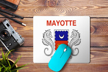 Mayotte Flag On Wooden Backgro...