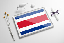 Costa Rica Flag In Wooden Frame On Table. White Natural Soft Concept, National Celebration Theme.
