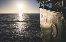 Stern Of An Old Ship At Sunset...