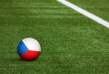 Czech Republic Flag On Ball At Soccer Field Background. National Football Theme On Green Grass. Sports Competition Concept.
