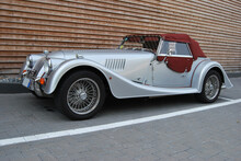 Silver Convertible Vintage Car With Burgundy Hood