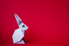 Simple Flat Lay Out. White Rabbit Paper Origami On Clear Background With Copy Space Concept