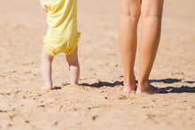 Young Mother And Baby Legs Sta...