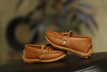 A Pair Of Brown Color Shoes Fo...