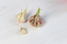 Fresh Young Garlic Bulbs On Wh...