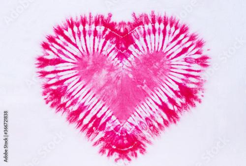 Fototapeta heart sign tie dye pattern on cotton fabric background. obraz
