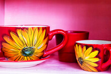 Set Of Red Mugs And Cups With ...