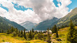 canvas print picture - panoramic view of a beautiful lake surrounded by the dolomites