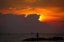 A Silhouette Of Fishermen Stan...