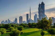 Dubai Skyline Across A Green P...