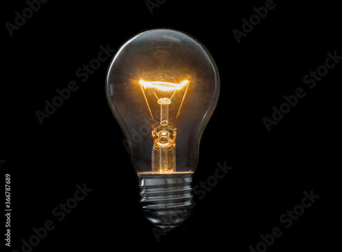 Obraz Old, dirty light bulb close up on black background - fototapety do salonu