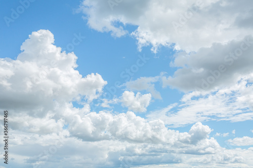 Blue sky with lots of beautiful altostratus and cumulus clouds. Wallpaper Mural