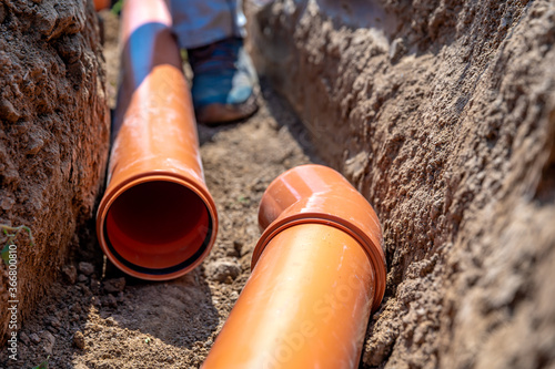 Fototapeta laying drainage pipes into the ground