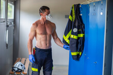 Serious Fireman With Naked Tor...