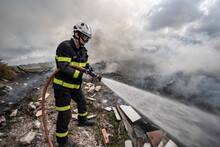Side View Of Brave Fireman In ...