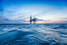 Offshore Oil Rig At Sunset Time