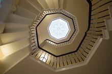 View From The Bottom Of A Spiral Staircase Looking Up To The Centre Point In The Roof Of An Art Deco Window,
