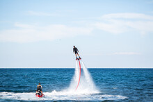 Silhouette Of A Fly Board Ride...