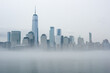 Freedom Tower and New York skyline on a foggy, misty day.