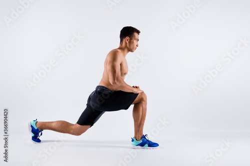 Obraz Full length body size profile side view of his he nice attractive sportive professional guy doing sit-up preparing contest shaping pilates yoga isolated over light white pastel color background - fototapety do salonu